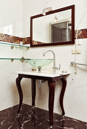 Modern bathroom interior with Glass sink bowl and mirror photo