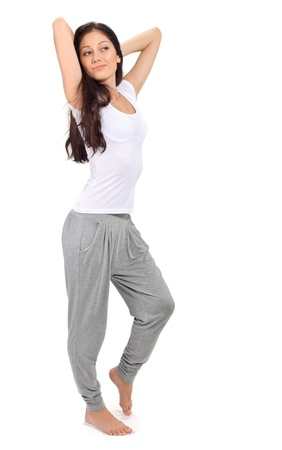 Young beautiful brunette girl stretching after awaking Stock Photo