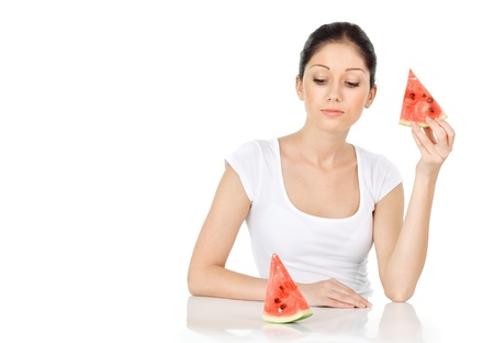 Young attractive woman with water melon isolated on white photo