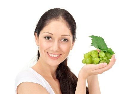 Young attractive woman with green grape cluster isolated on white photo