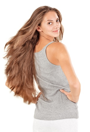 Young beautiful woman with flying long hairs on white photo