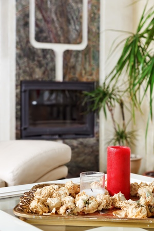 Still life with red candle and dried rose flowers on a gold tray Stock Photo - 8679198