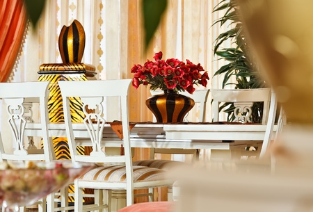 Part of modern art deco styledining room interior with golden striped vase and red flowers Stock Photo - 8679202