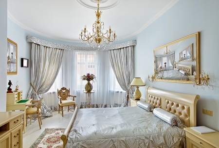 Classic style luxury bedroom interior in blue colors with boudoir and window photo
