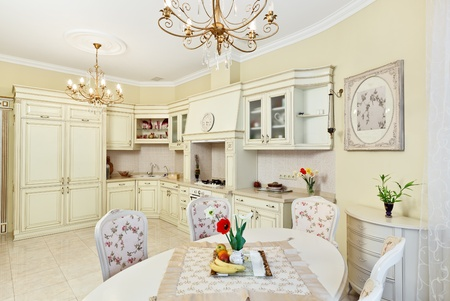Classic style kitchen and dining room interior in beige pastoral colors photo