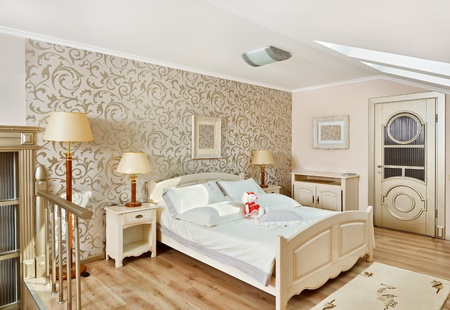 roof apartment: Modern art deco style bedroom interior in light beige colors on loft room