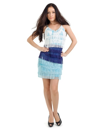 Young pretty lady in blue dress full-length studio portrait on white photo