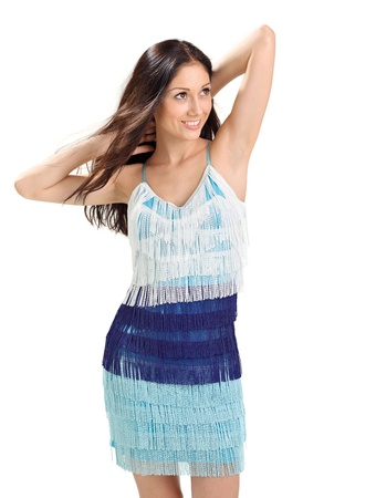 Young pretty lady in blue fringed sun-dress studio portrait on white photo