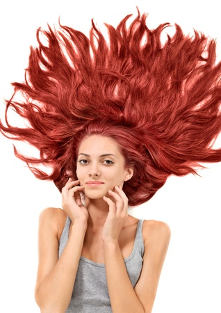 Young beautiful redhead woman with scattered long hairs on white Stock Photo - 8771316