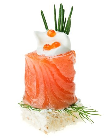 Elegant canape with salmon roll, toast, rosemary twig and caviar isolated on white Stock Photo - 8891327