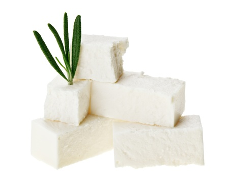 Feta cheese cubes with rosemary twig, isolated on white Stock Photo