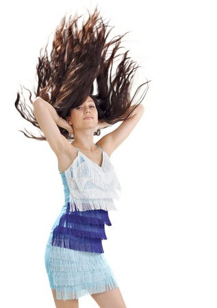 Young pretty lady in blue dress with long hairs flying upwards studio portrait on white photo