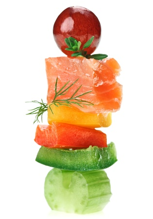 Elegant canape with salmon fish, celery, dill twig and grape isolated on white