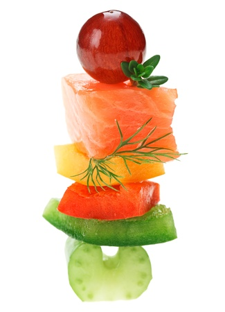 canape: Elegant canape with salmon fish, celery, dill twig and grape isolated on white