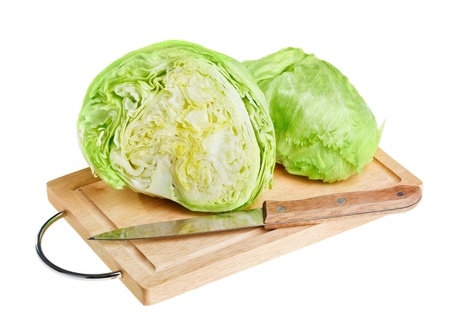 Fresh green iceberg lettuce with knife on wooden chopping board over white background photo