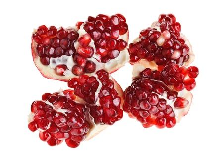 incarnadine: Juicy ripe open pomegranate piece isolated on white background macro