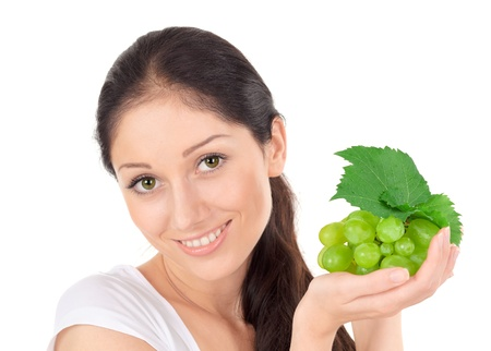 Young attractive lady with green grape cluster isolated on white Stock Photo - 9086635