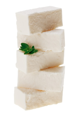 Feta cheese cubes with thyme twig, isolated on white photo