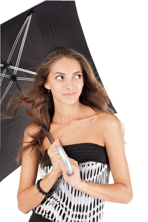 Young beautiful woman with black umbrella portrait photo