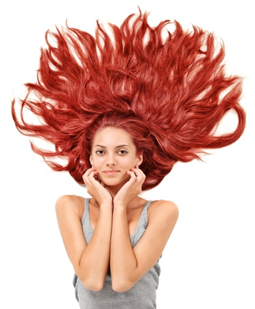 Young beautiful redhead woman with scattered long hairs on white photo