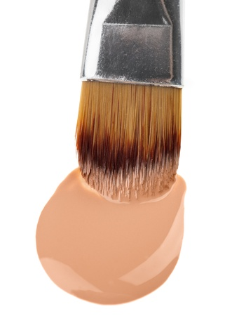 Beige liquid foundation makeup stroke with brush, isolated on white Stock Photo - 9452531