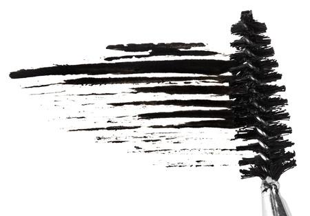 beroerte: Slag van zwarte mascara met borsteltje, geïsoleerd op wit macro