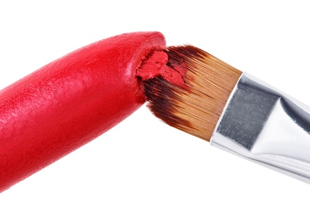 Makeup brush pushed in on red lipstick, isolated on white Stock Photo - 9452591