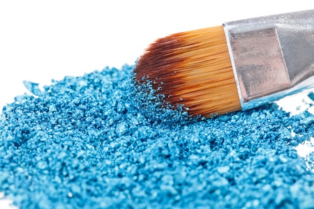 Makeup brush with blue crushed eye shadow, isolated on white macro Stock Photo - 9452600