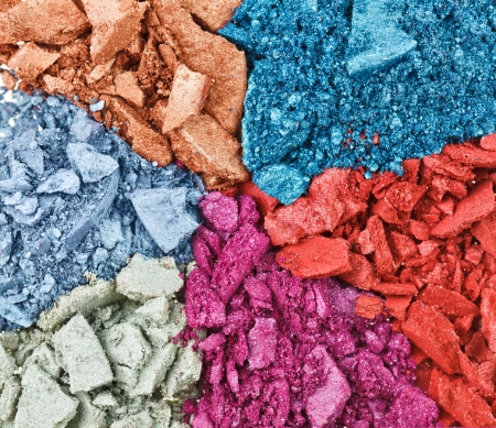 Set of broken multicolor eye shadow,  background macro Stock Photo