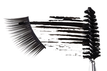 Black mascara stroke, brush and false eyelashes abstract composition, on white Stock Photo - 9567841