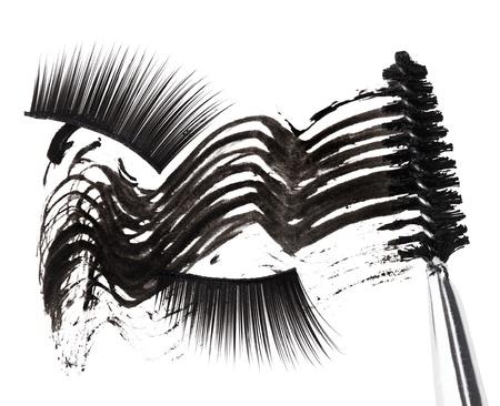Black mascara stroke, brush and false eyelashes abstract composition, on white Stock Photo - 9567844