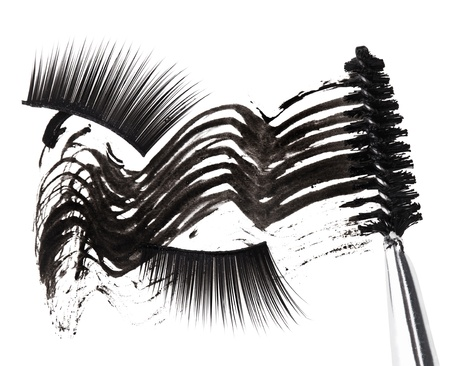 Black mascara stroke, brush and false eyelashes abstract composition, on white Stock Photo - 9567844
