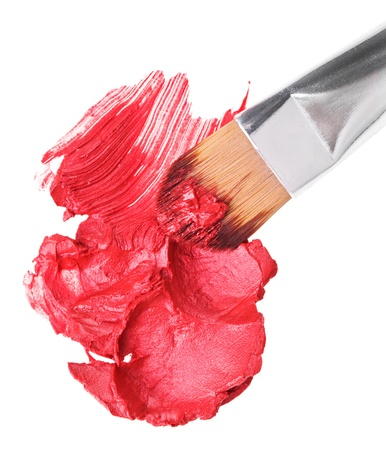 Red lipstick stroke (sample) with makeup brush, isolated on white Stock Photo - 9567860