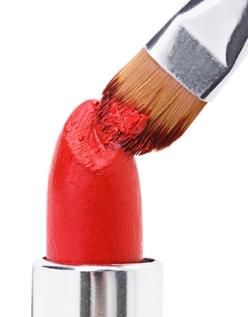 Makeup brush pushed in on red lipstick, isolated on white Stock Photo - 9567854