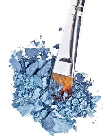Makeup brush with grey blue crushed eye shadow, isolated on white macro Stock Photo - 9567867