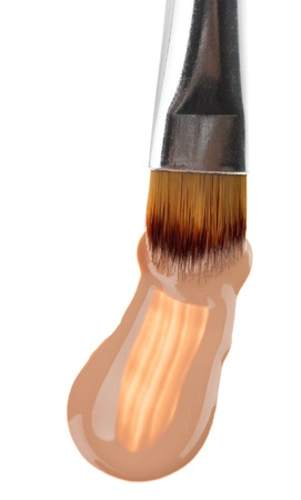 Beige liquid foundation makeup stroke with brush, isolated on white Stock Photo - 9963842