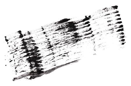 Stroke (sample) of black mascara, isolated on white macro photo