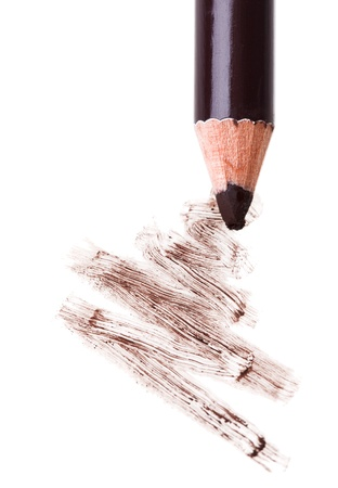 Eye shadow makeup pencil with stroke sample, isolated on white macro photo