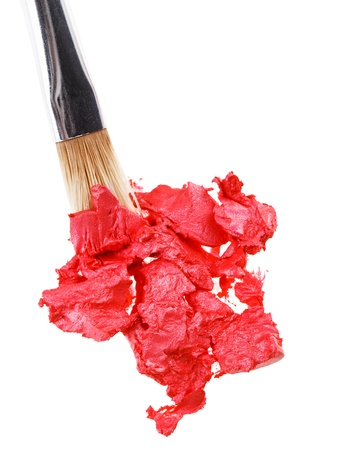 Red lipstick stroke (sample) with makeup brush, isolated on white Stock Photo - 9963856