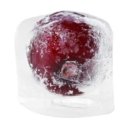 Red sweet cherry inside of melting ice cube, isolated on white photo
