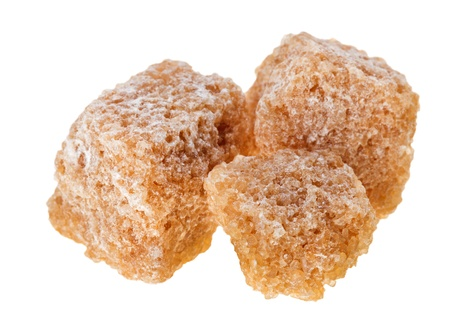 sucrose: Three brown lump cane sugar cubes, isolated on white Stock Photo