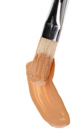 Beige liquid foundation makeup stroke with brush, isolated on white Stock Photo - 10319263