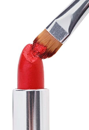 Makeup brush pushed in on red lipstick, isolated on white Stock Photo - 10319285