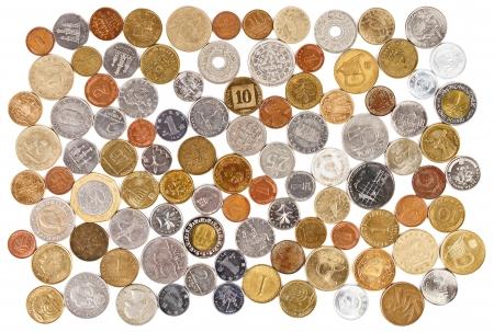 monedas antiguas: Colección de muchas monedas diferentes en el fondo blanco Foto de archivo
