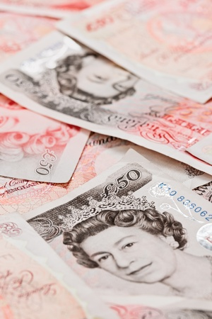 pound sterling: 50 pound sterling bank notes closeup view business background