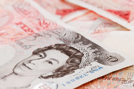 dosh: 50 pound sterling bank notes closeup view business background