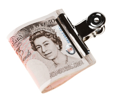 quid: Bundle of 50 pound sterling bank notes fasten with paper clip, isolated  on white