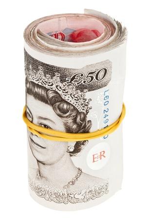 libra esterlina: Libra esterlina enrollado billetes de banco, aislado en blanco