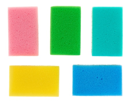 Five multicolored cellulose kitchen sponges, isolated on white photo