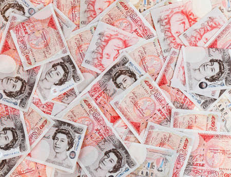 pound sign: 50 pound sterling bank notes closeup view business background